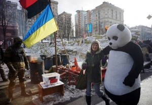 "Even passing the barricades, there are distinct ""Life As Usual"" elements clearly visible. Come for the revolution, stay for a picture with a guy in a panda suit. 