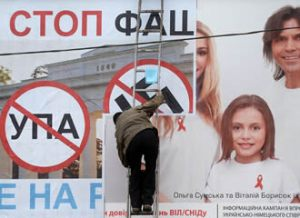 Anti-Kyiv billboard... being plastered over an AIDS awareness advert. Image: Filippo Monteforte / AFP / Lehtikuva