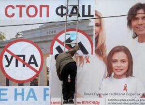 Anti-Kyiv billboard... being plastered over an AIDS awareness advert. Image: Filippo Monteforte / AFP / Lehtikuva