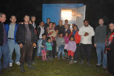 "Gathering with Roma to worship in their ""church building"" - a shipping container. Dicanesti, Romania."