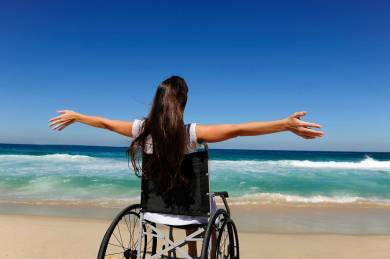 disabled-woman-in-wheelchair-at-heaven-beach